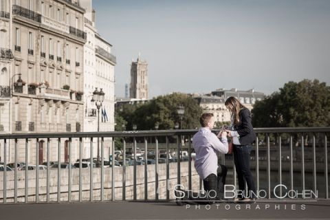 surprise proposal in paris couple in love focus ring at sunrise emotion