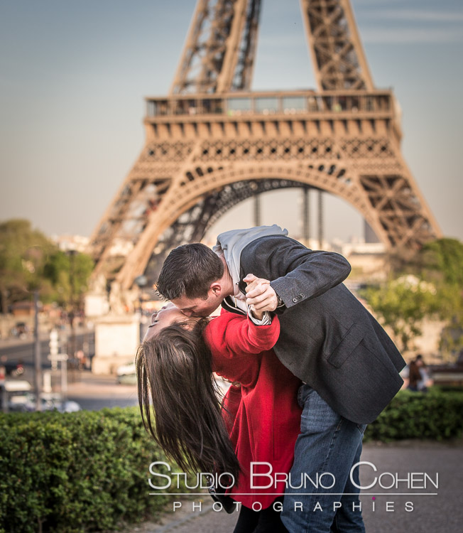 portrait dancing couple in love from Trocadero front of Eiffel Tower paris kiss red dress lay asian