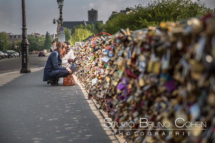 portrait couple in love make love lock from lock bridge in paris proposal