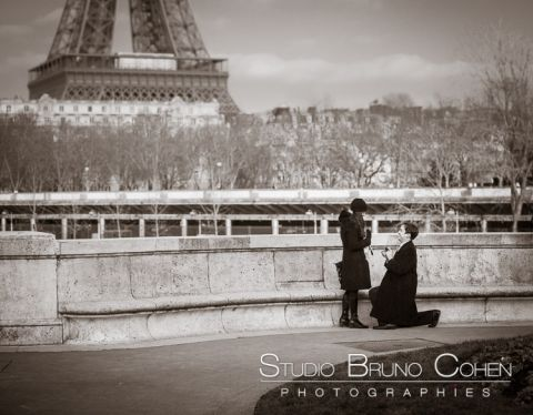 surprise proposal in paris couple love front of Eiffel Tower black and white
