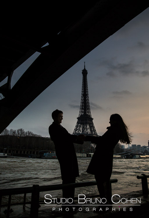 fashion portrait couple in paris front Eiffel Tower at sunset love smile
