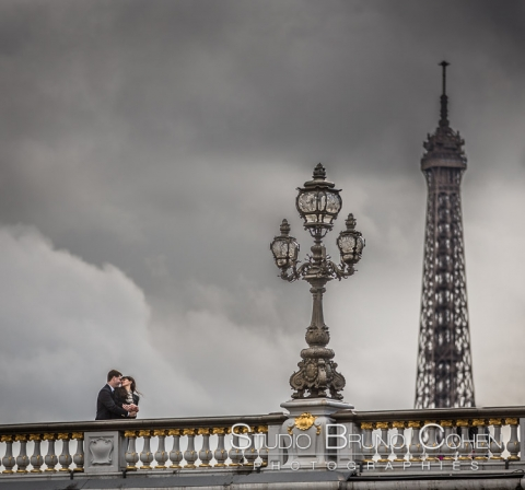 proposal in paris couple in love from Alexandre three bridge front of Eiffel Tower