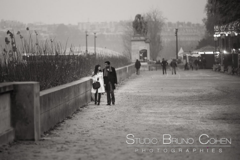 portrait couple in love walk in paris at sunset winter black and white