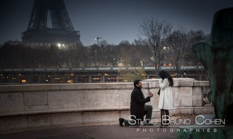 surprise proposal in paris couple in love emotions happy smile cry front Eiffel Tower at night winter