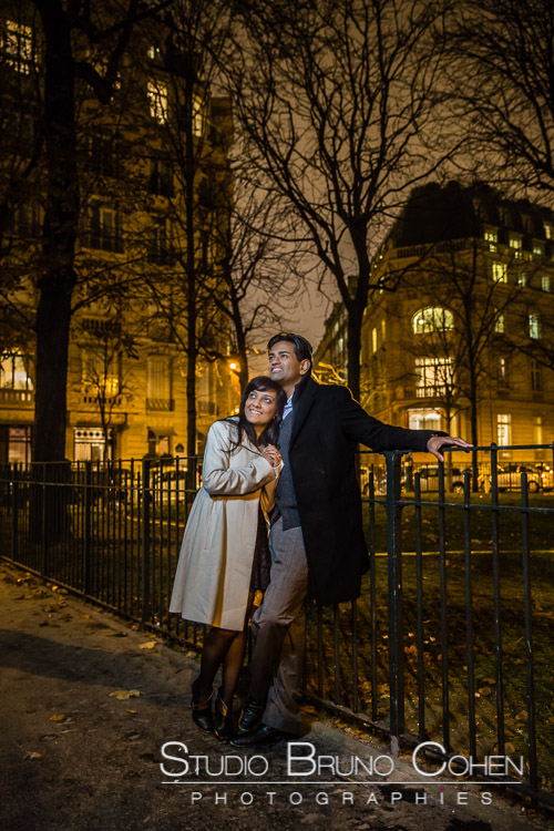 portrait couple in love in paris at night winter proposal engagement session