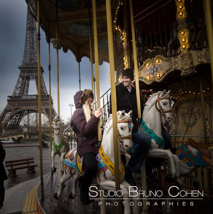 portrait couple riding horses at carousel Eiffel Tower in paris smile love happy valentine day