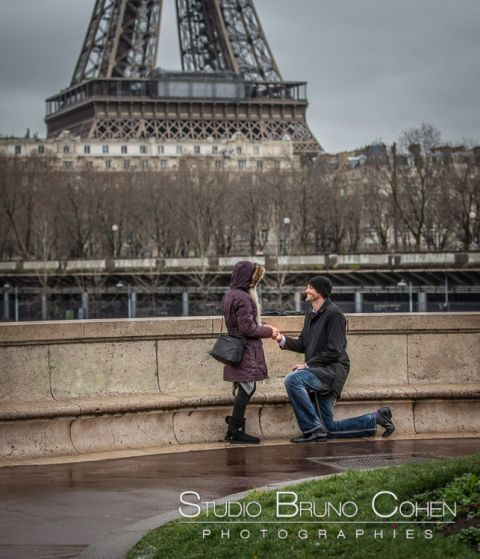 surprise proposal in paris valentine day couple in love engagement session front of Eiffel Tower