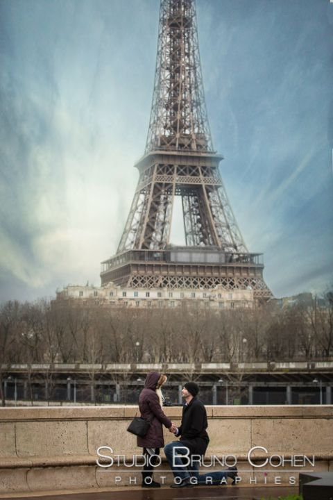surprise proposal in paris valentine day front of Eiffel Tower blue sky winter couple in love smile happy