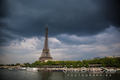 proposal in paris Eiffel Tower cloudy storm