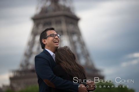 couple hugging front of Eiffel Tower proposal in paris