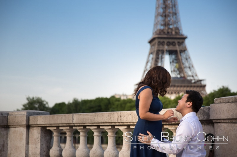 proposal in paris couple emotions in love cry lady asian from bir Hakeim bridge front of Eiffel Tower at sunrise
