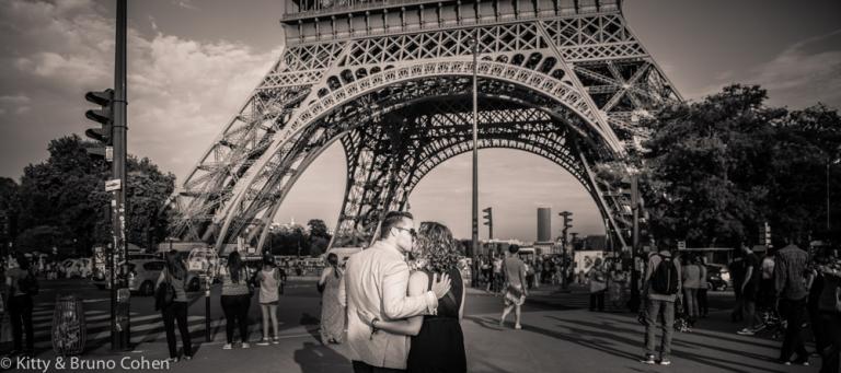 Proposal in paris near Pont Iena black and white couple kiss