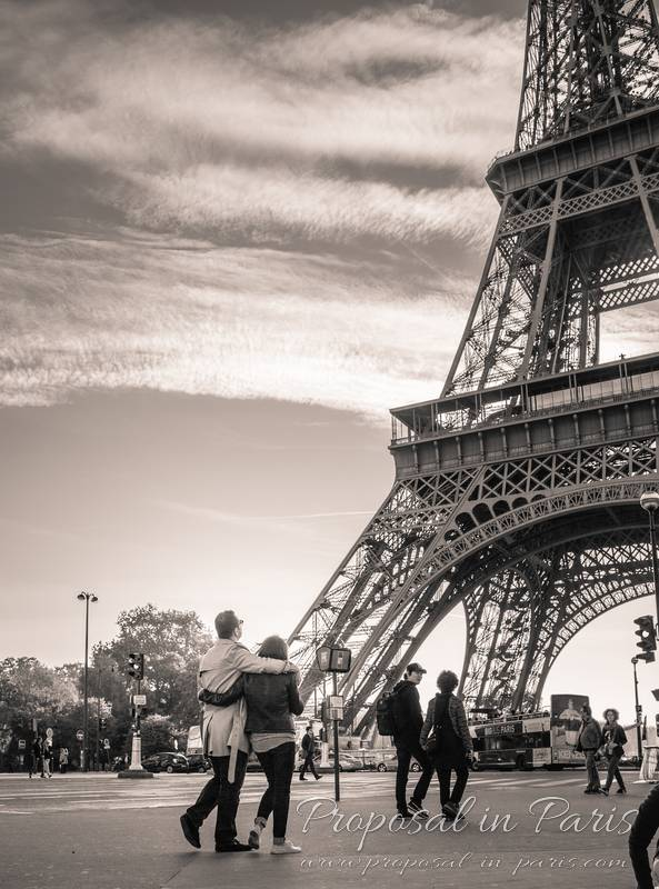 couple in love front of eiffel tower black and white proposal in paris
