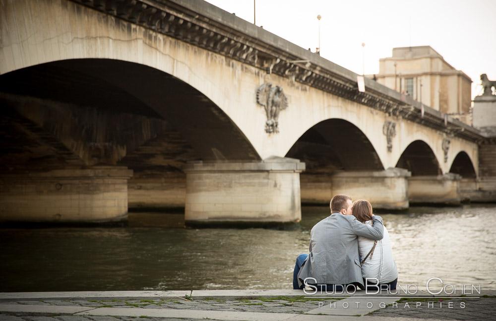 hugging couple from quai de seine near eiffel tower at paris