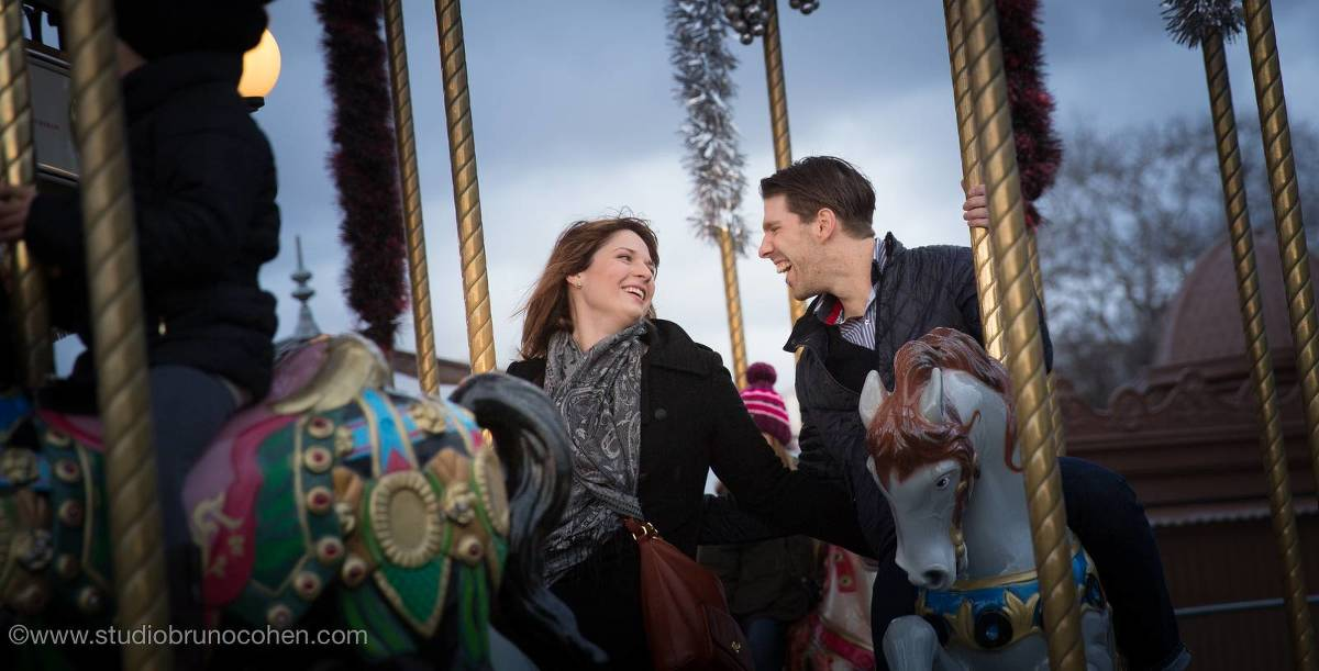 portrait couple riding horses on carousel Eiffel Tower in paris proposal winter night love
