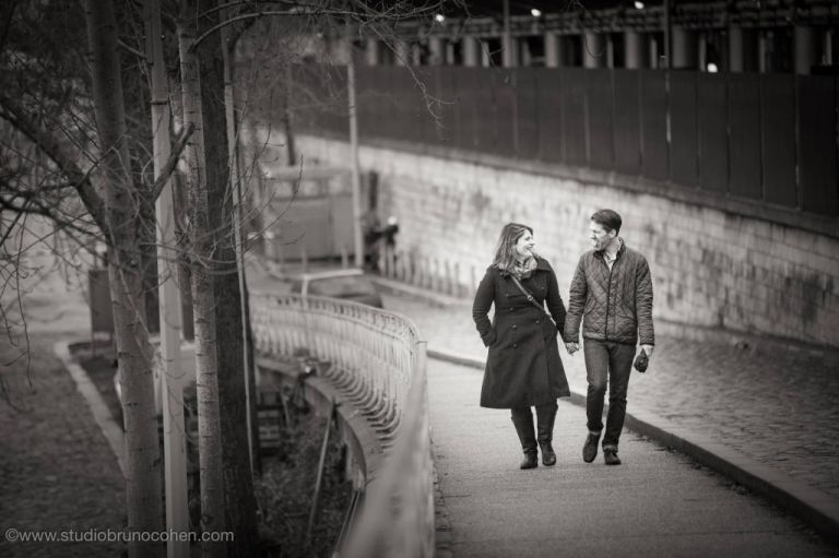 portrait couple hand in hand walk in paris engagement session love black and white