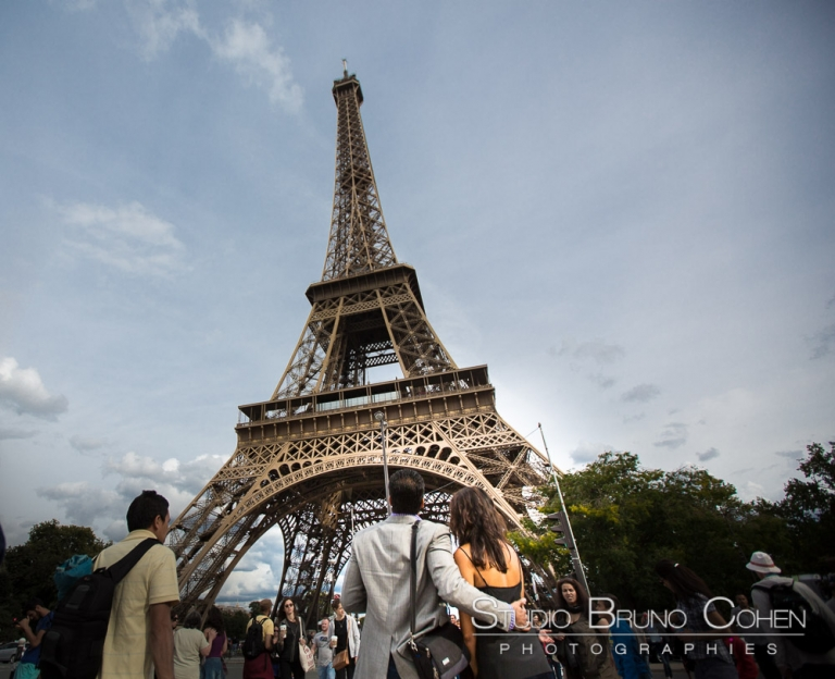 couple in love from paris front of eiffel tower proposal surprise