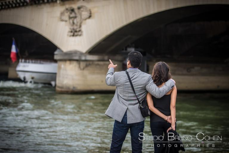 couple in love from paris proposal portrait quai de seine near eiffel tower