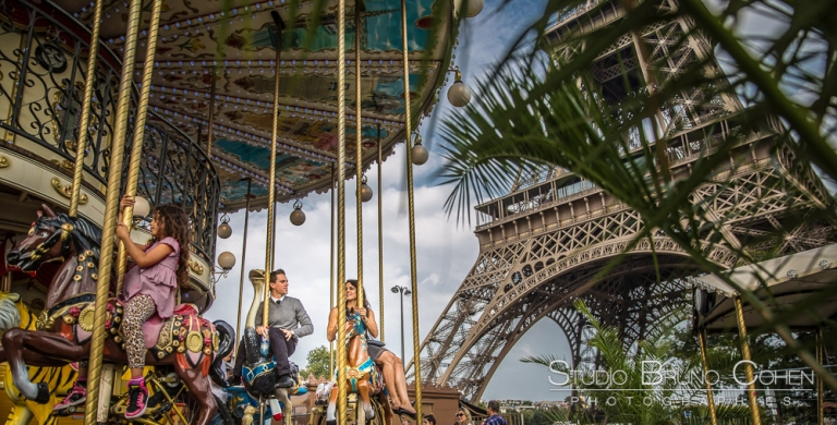 couple riding on horses at eiffel tower carousel proposal in paris summer
