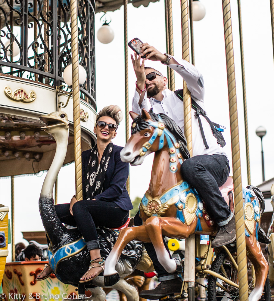 couple ride on horses from eiffel tower carousel proposal in paris