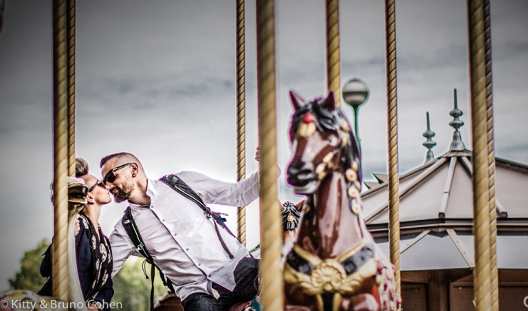 kissing couple on horses from eiffel tower carousel proposal in paris