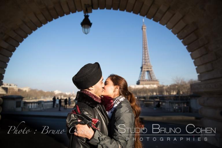 kiss under Bir-Hakeim Bridge front of Eiffel Tower in paris love couple