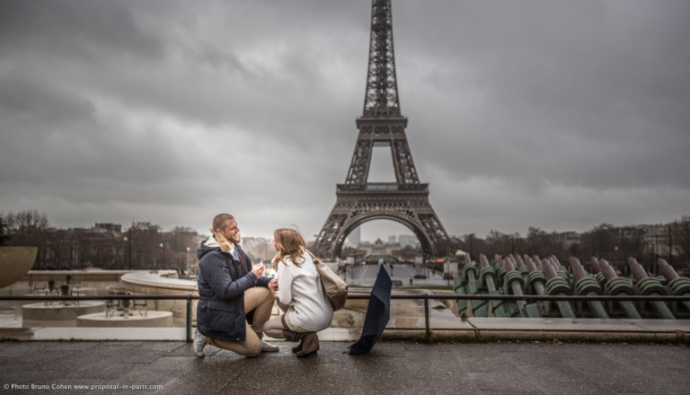 surprise proposal in Paris from Trocadero square front of Eiffel Tower at winter morning emotions cry