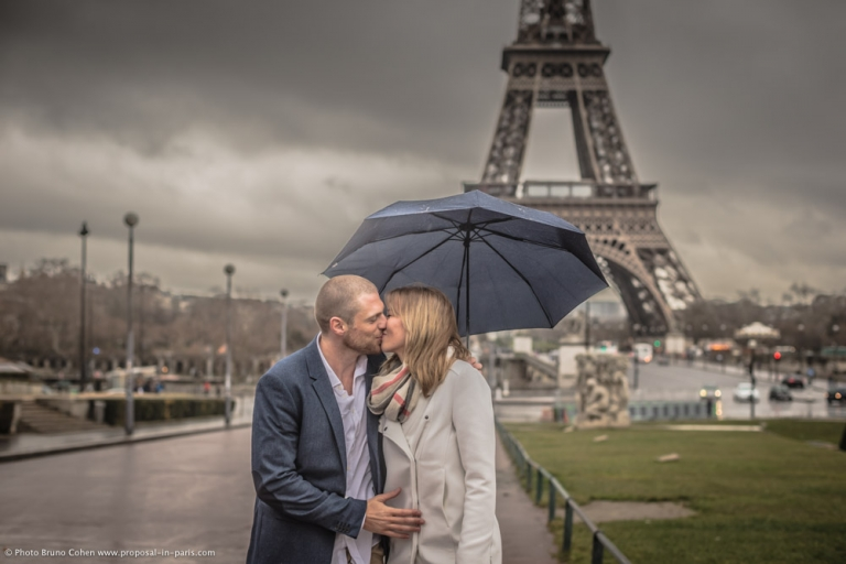 portrait kissing couple in love from Trocadero square front of Eiffel Tower proposal at winter morning emotions kiss