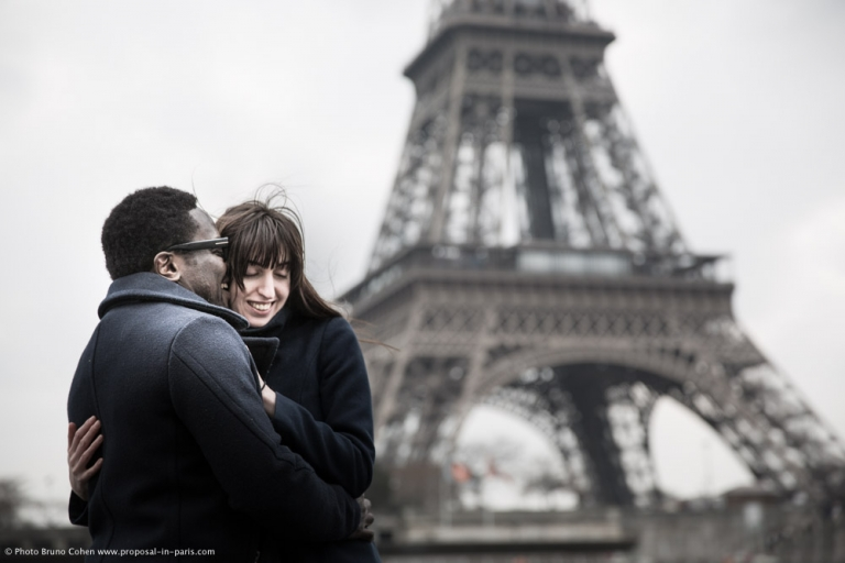 Beloved photographer paris hugging couple in love front Eiffel Tower Trocadero place