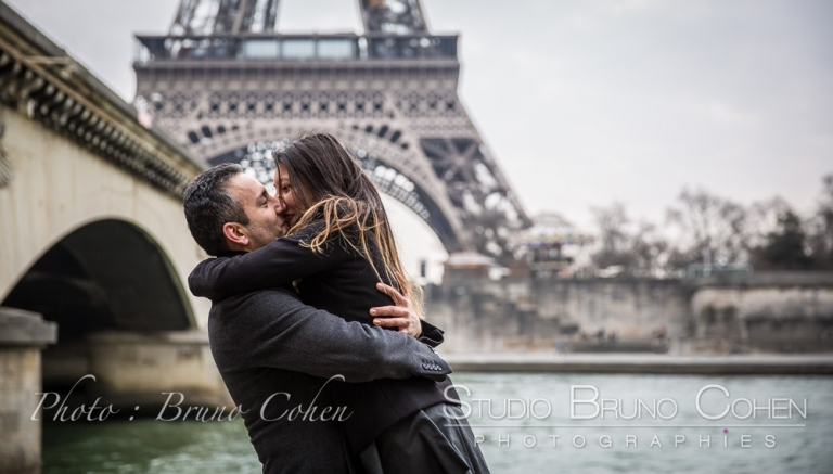 proposal in  paris kissing couple from seine banks near Pont d'Iena front of Eiffel Tower