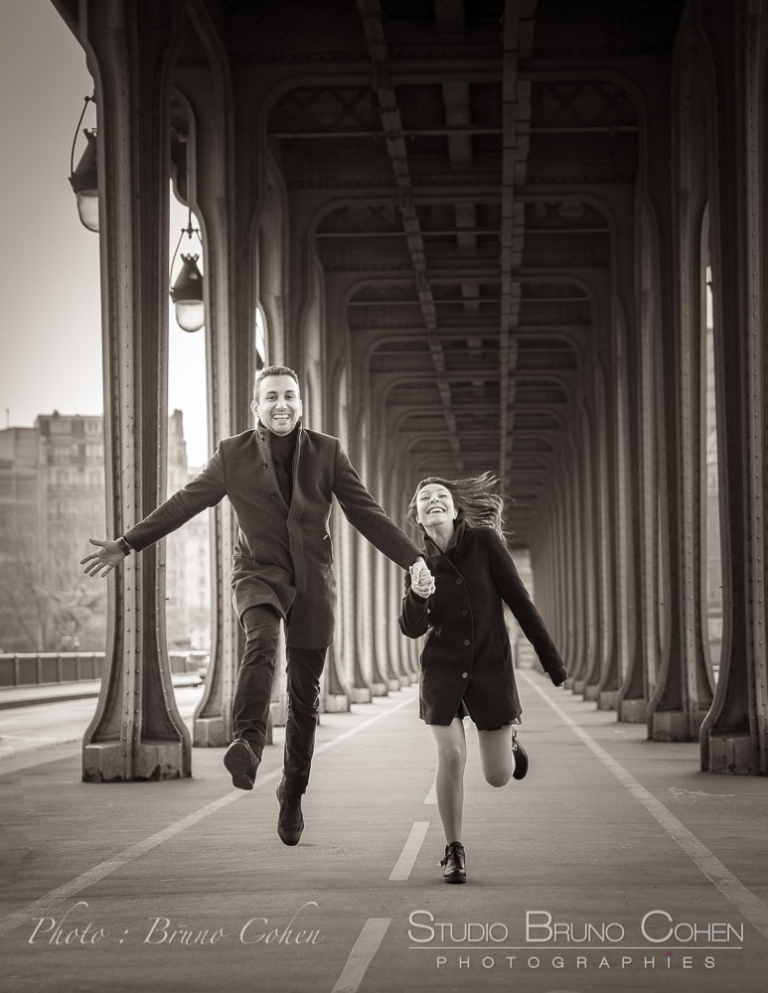 Engagement session from Bir-Hakeim bridge jumping couple in love happy black and white