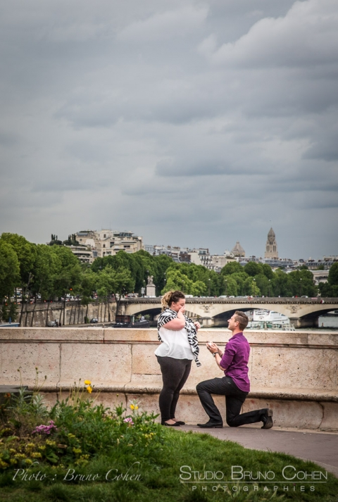 lady crying during a surprise proposal in paris at Bir Hakeim bridge