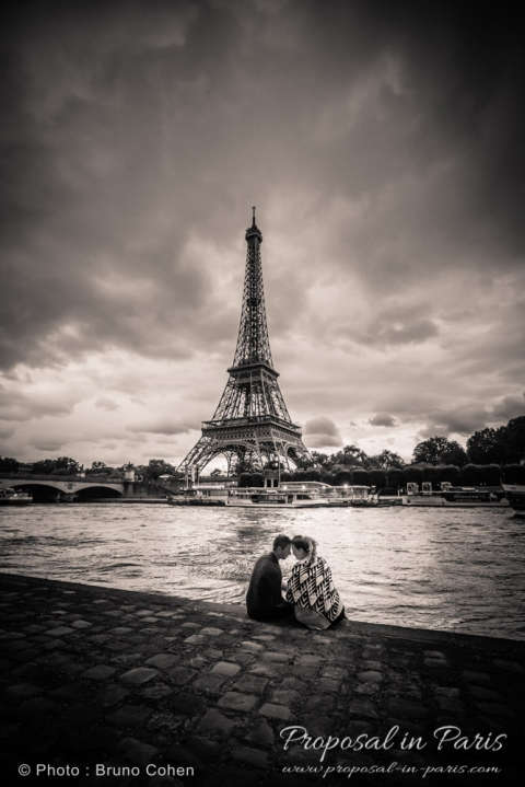 engagement session in Paris couple in love forehead to forehead from seine banks black and white