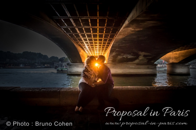 engagement session in Paris under iena bridge at sunset kissing couple love