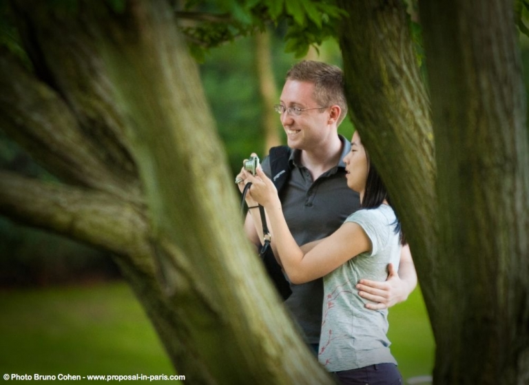portrait couple in love romantic proposal in paris from Luxembourg gardens smile