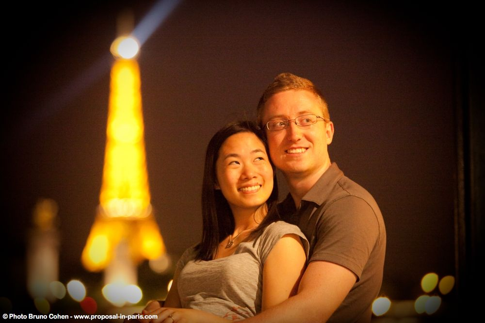 portrait couple in love from paris front of Eiffel Tower at night
