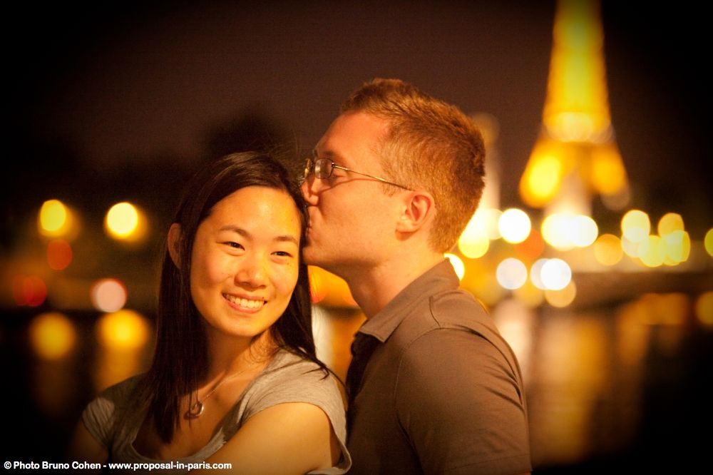portrait couple in love from paris near Eiffel Tower at night