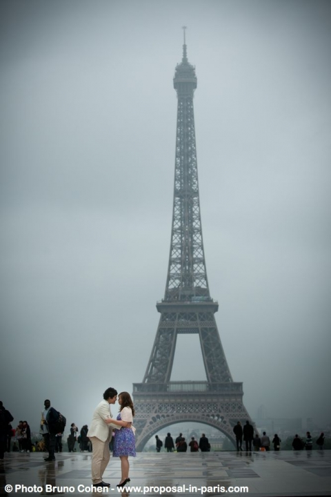 asian couple in love from Trocadero front of Eiffel Tower proposal