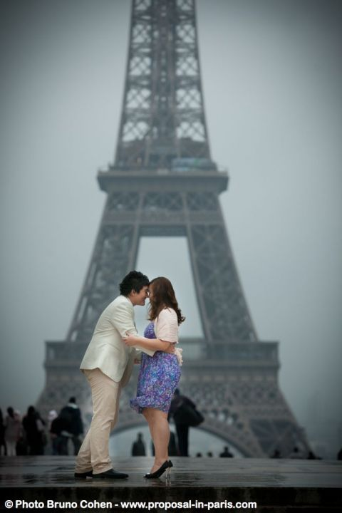 asian couple forehead against forehead from Trocadero front of Eiffel Tower  at sunrise in love