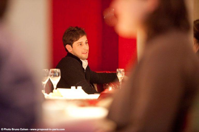 proposal in paris restaurant deda men romantic notre dame smile happy love couple