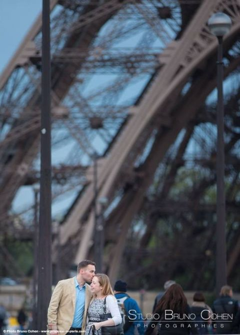 portrait couple in love hugs front of Eiffel Tower at sunset