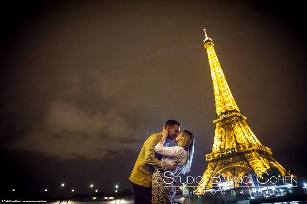 portrait kissing couple at night in paris front of Eiffel Tower fashion love smile