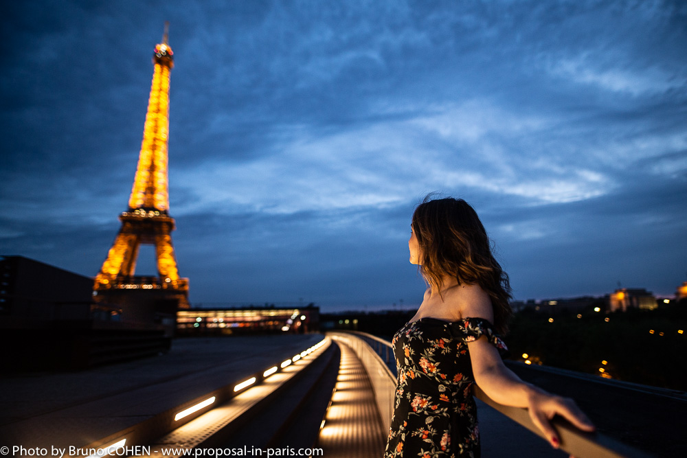 portrait lady look far away by night in paris front of Eiffel Tower