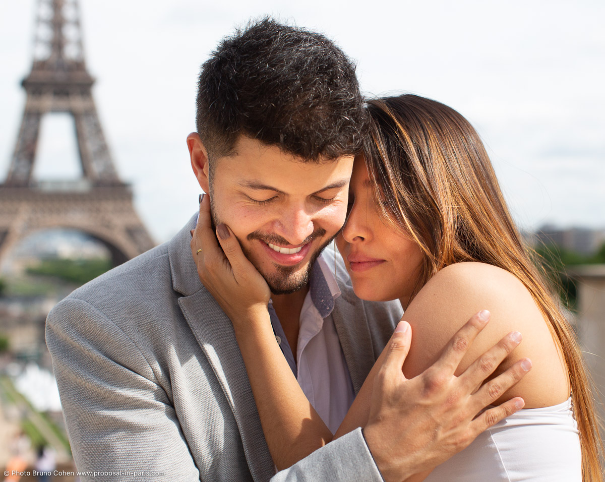 portrait couple in love smiling front of Eiffel Tower