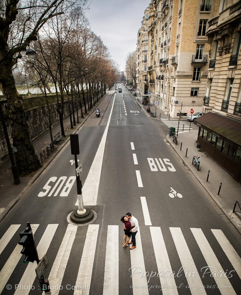 original portrait couple in love on the road in paris near Eiffel Tower