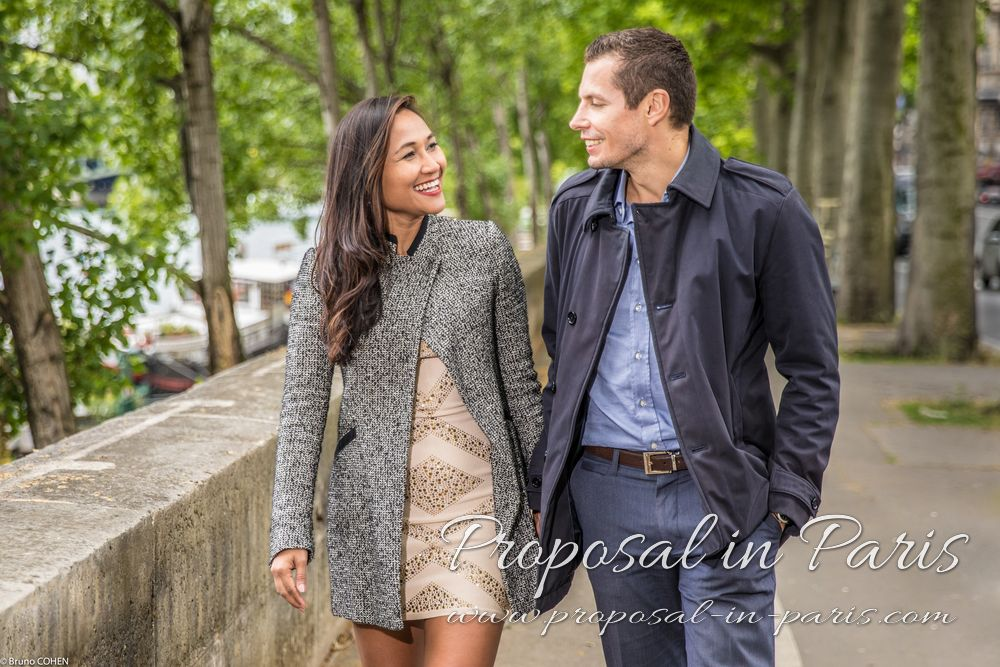 portrait couple holding hands and walk in paris near Eiffel Tower