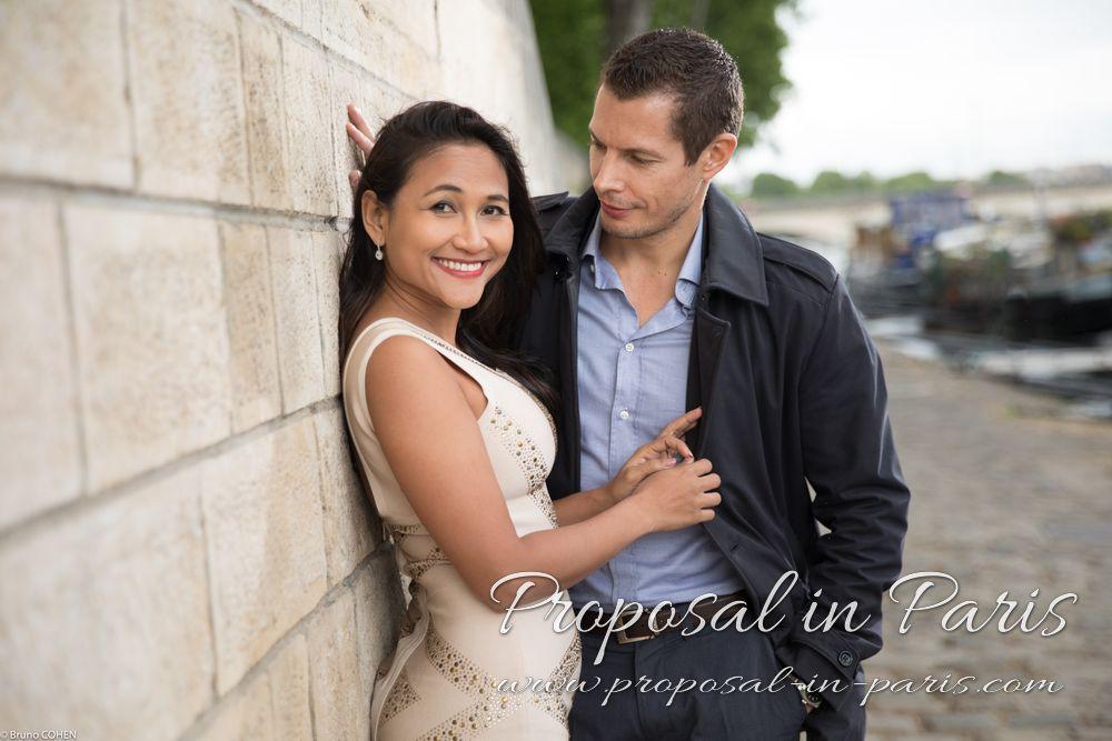 portrait couple in love standing in quai de seine near Eiffel Tower