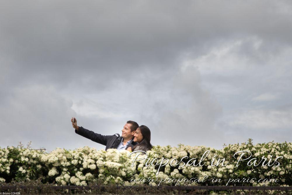 couple in love taking selfie in paris proposal