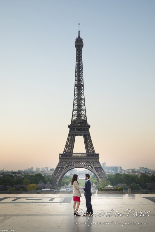 couple holding hands in love from Trocadero front of Eiffel Tower at sunrise