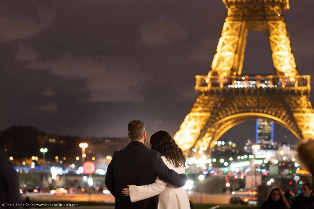 couple in love in front of Eiffel Tower by night